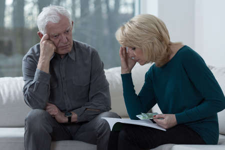 financial problems: Picture of older couple troubled by financial problems