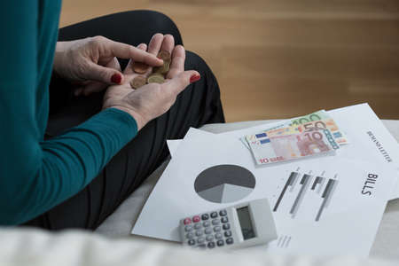 penniless: Close-up of penniless older woman counting her money