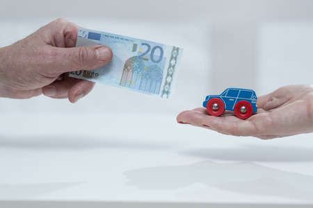 penniless: Close-up of mans hand holding the car fee