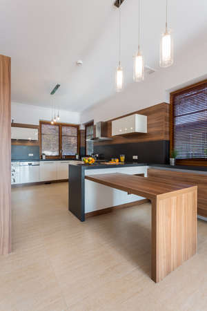kitchen countertops: Interior of contemporary kitchen with wooden elements