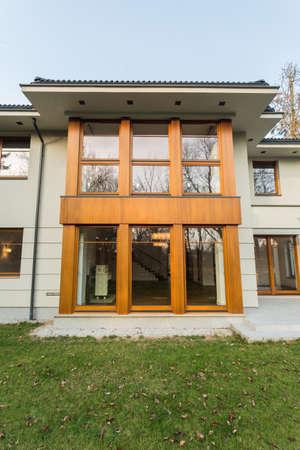 single dwelling: Fasade of luxury mansion with big windows