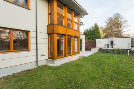 single family home: Single-family house exterior with beauty garden