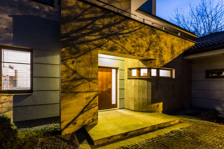 suburban home: External view modern detached house at night Stock Photo
