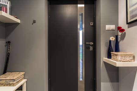 Modern black front door to new luxury house photo
