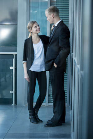Young couple working together in business center photo