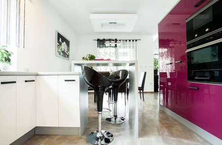 kitchen furniture: View of luxurious kitchen with purple furniture