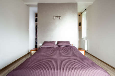 view an elegant wardrobe: View of big bed in a bedroom Stock Photo