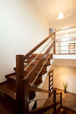 exclusive photo: Picture of wooden stylish stairs to bedroom on the floor Stock Photo