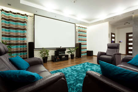 home theatre: View of movie theatre in modern house