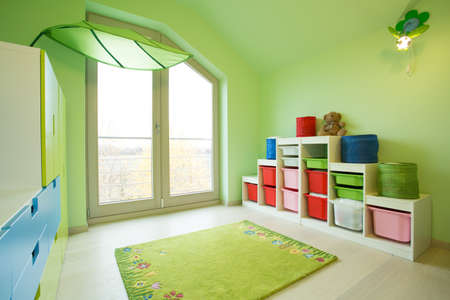 View of children room with green walls photo