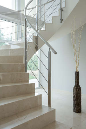 luxurious interior: Beige marble stairs inside the apartment