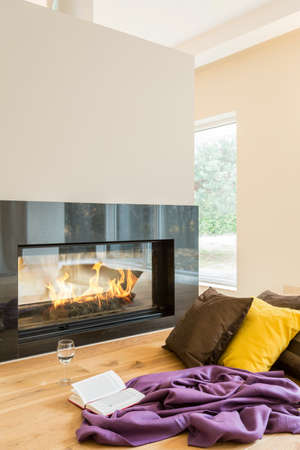 heat home: Resting place by the fireplace in a beautiful apartment Stock Photo