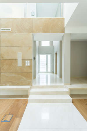Empty and long corridor in huge apartment photo