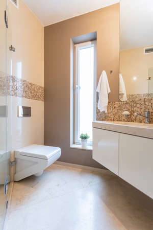 Cozy and beige bathroom in the apartment photo