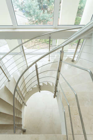 Spiral marble stairs in new apartment photo