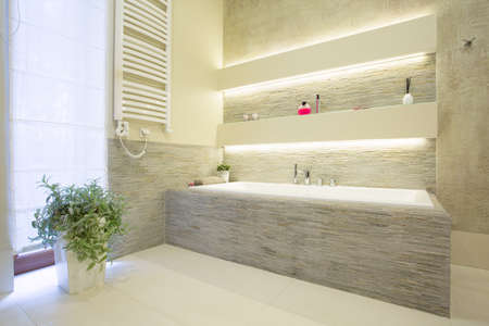bathroom tile: Image of luxury stone bathtub in new washroom Stock Photo