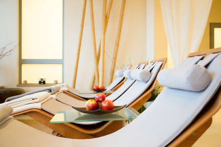 Close-up of wooden fancy loungers in restful room