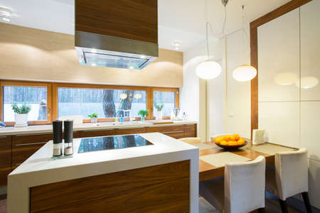 contemporary kitchen: Furnished and cozy kitchen in modern house