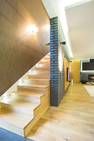 designed: View of wooden staricase inside designed apartment