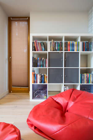 pouf: View of red pouf inside modern room Stock Photo