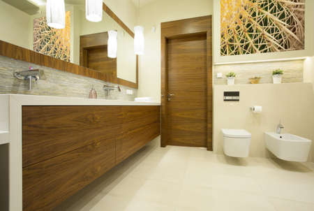 Spacious contemporary washroom with long wooden basin