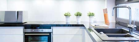 View of black and white kitchen interior