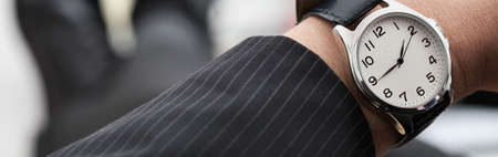 panoramic business: Businessman with a watch on his hand Stock Photo