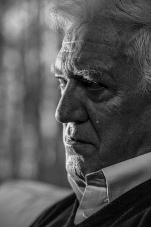 Black and white portrait of senior man crying photo