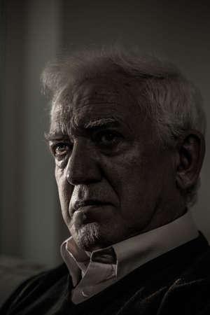 major depression: Portrait of sad male pensioner having major depression