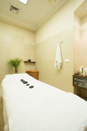 restful: Restful white bed with hot stones for massage