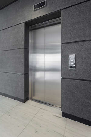 adapted: Elevator in office adapted to clients using wheelchair Stock Photo