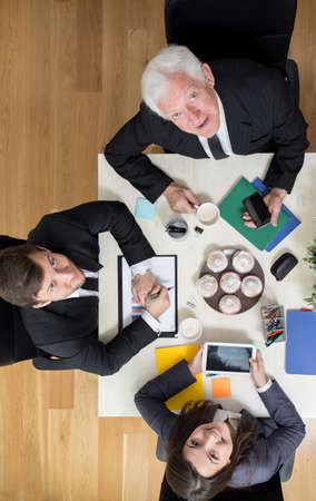 assemblage: Busy businesspeople during assemblage in company