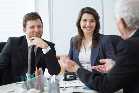 Three entrepreneurs during business conversation