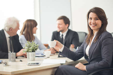 assemblage: Young pretty businesswoman during company assemblage