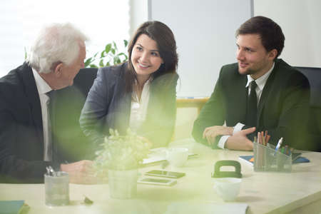 three persons: Three businesspeople during debate in conference room Stock Photo