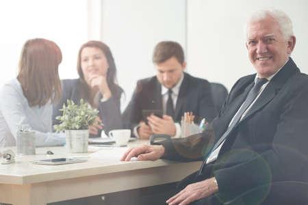 Elderly happy entrepreneur during business meeting Stock Photo