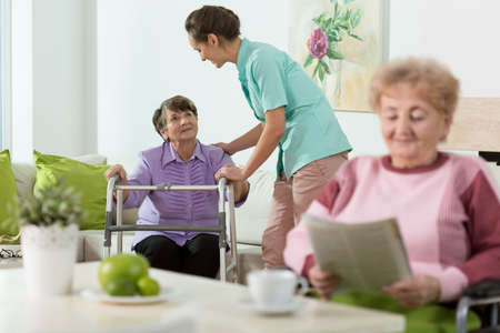 Disabled senior women staying in care home Stockfoto