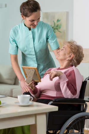 social work aged care: Image of nurse caring about handicapped woman