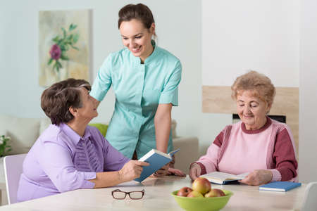 social work aged care: Image of nurse working in residential home