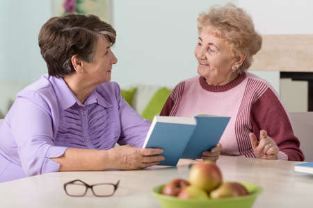 nursing sister: Portrait of senior women sitting at the table