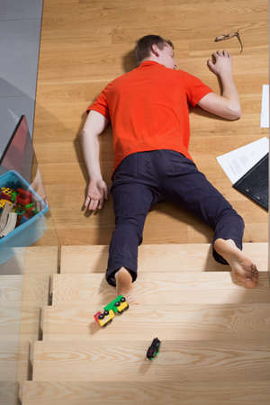 stumble: Accident at home - man falling down from the stairs