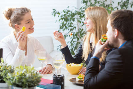 lunch meeting: Three businesspeople on their brunch during conference