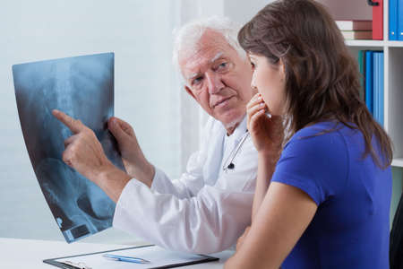 chest xray: Doctor watching x-ray photo with his patient