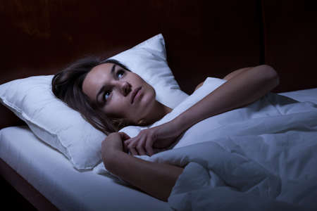 girls night: View of woman feeling depression in bed Stock Photo