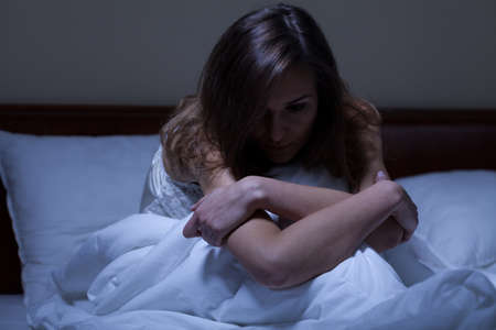 View of awake woman suffering from depression Stock Photo