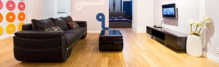 Panoramic view of bright, designed apartment interior photo