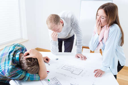 Horizontal view of tired architects at work Stock Photo
