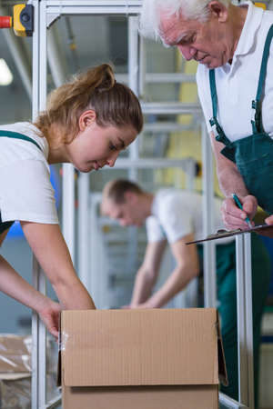 Close-up of young working woman in warehouse photo