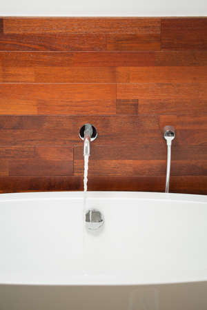 bathwater: Close-up of exclusive bathtub with wooden wall