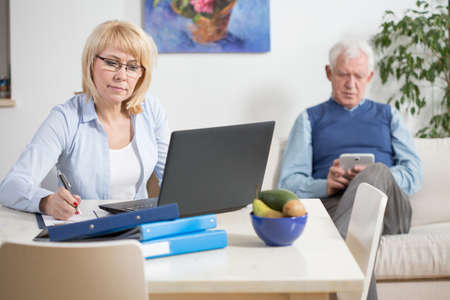 home expenses: Elderly businesswoman making a plan of expenses